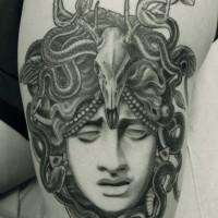 Eye blind Medusa Gorgon with animal skull on top thigh tattoo