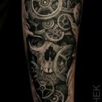 Fantastic black ink forearm tattoo of under skin gearwheels and human skull