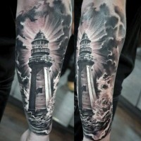Fantastic detailed natural looking black and white lighthouse tattoo on wrist