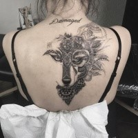 Fantastic looking back tattoo of wolf head stylized with ornaments and lettering