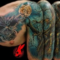 Fantastic looking colored horror style monster zombie sitting on shoulder tattoo