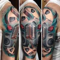 Fantastic painted 3D like music themed half sleeve tattoo