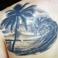 Fantastic painted very beautiful waves with palm tree tattoo on shoulder