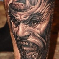 Fantasy illustrative style demonic gorilla tattoo on leg