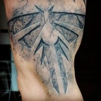Fantasy style black ink biceps tattoo of interesting symbol