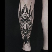 Fantasy style black ink painted by Michele Zingales leg tattoo of demonic mask