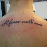 Fiery impressions tattoo on back