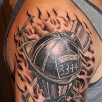 Firefighter memorial black and grays style shoulder tattoo with lettering