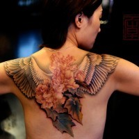 Flowers and wings tattoo on back for women
