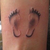 Footprint baby foot tattoo on wrist for men