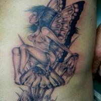 Forest fairy sitting on a mushroom tattoo