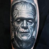 Frankenstein Monster in gray colors tattoo