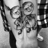 Funny cartoon like sketch style tattoo by Inez Janiak of angry doll