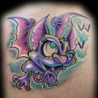 Funny cartoon style colored vampire bat tattoo