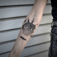 Funny cartoon style forearm tattoo