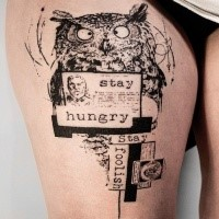 Funny creative black ink thigh tattoo of owl with human portrait and lettering