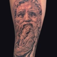 Funny designed black and white antic statue tattoo on forearm with bunny ears