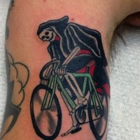 Funny grim reaper on cycle colored tattoo on biceps