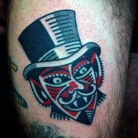 Funny little colored vampire gentleman tattoo on thigh