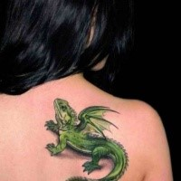 Funny looking 3D style green colored small dragon lizard tattoo on upper back