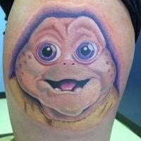 Funny looking cartoon style little baby alien tattoo on thigh
