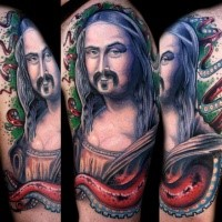 Funny looking colored arm tattoo of amazing Madonna