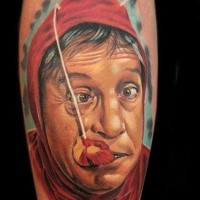 Funny looking colored arm tattoo of strange looking man