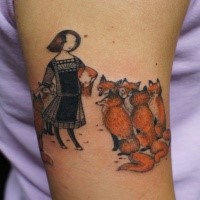 Funny looking colored arm tattoo of woman with foxes