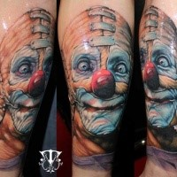 Funny looking colored crazy clown tattoo