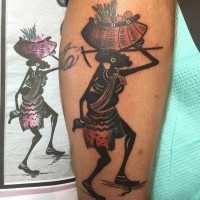 Funny looking colored leg tattoo of tribal worker with basket