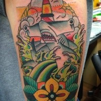 Funny old school style arm tattoo of hammerhead shark with waves and flower