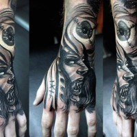 Futuristic black ink horrifying vampire woman with eye tattoo on wrist