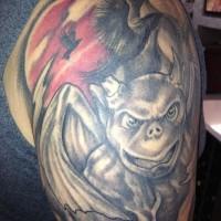 Gargoyle with black raven tattoo on shoulder