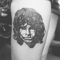 Geometric style black and white thigh tattoo of woman portrait