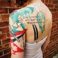Geometrical colored scapular tattoo of various figures with lettering by Dino Nemec