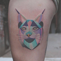 Geometrical style colored thigh tattoo of wild cat