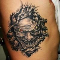 Ghoulish demon under skin rip tattoo