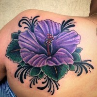 Giant violet hibiscus flower with black elements colored shoulder blade tattoo Hawaiian themed