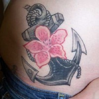 Girly traditional anchor tattoo with large flower
