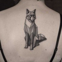 Gorgeous black and white fox tattoo on woman's back in geometrical style