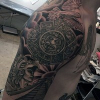 Gorgeous black ink shoulder tattoo of Mayan warrior with temple and pigeon