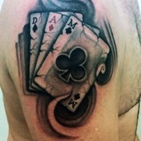 Gorgeous colored playing cards upper arm gambling tattoo