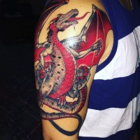 Gorgeous designed and colored shoulder tattoo of fantasy dragon