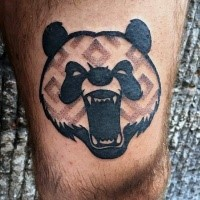 Gorgeous looking black ink thigh tattoo of evil panda head