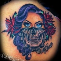 Gorgeous looking colored upper back tattoo of woman face with skull part