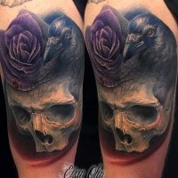 Gorgeous new school style detailed colored shoulder tattoo of human skull with crow and pink rose