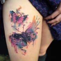 Gorgeous pair of colorful butterflies tattoo on lady;s thigh in watercolor style