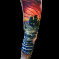 Gorgeous very beautiful colored sunset with ship and palm tree tattoo on sleeve
