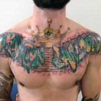 Graffiti style colored chest tattoo of wall lettering with crown