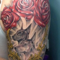 Gray-ink doberman couple with red roses tattoo on upper arm